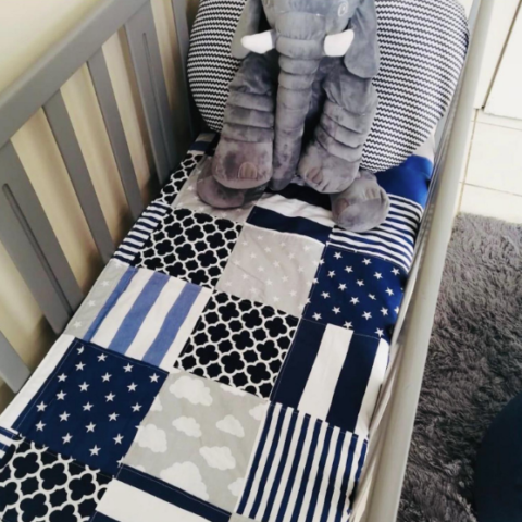Cot quilts by powwow teepees
