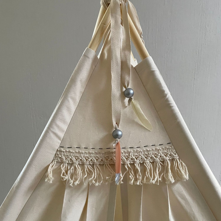 Classic cream teepee with trim and hand finished detail