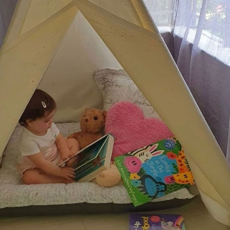 Use a teepee as a reading nook.