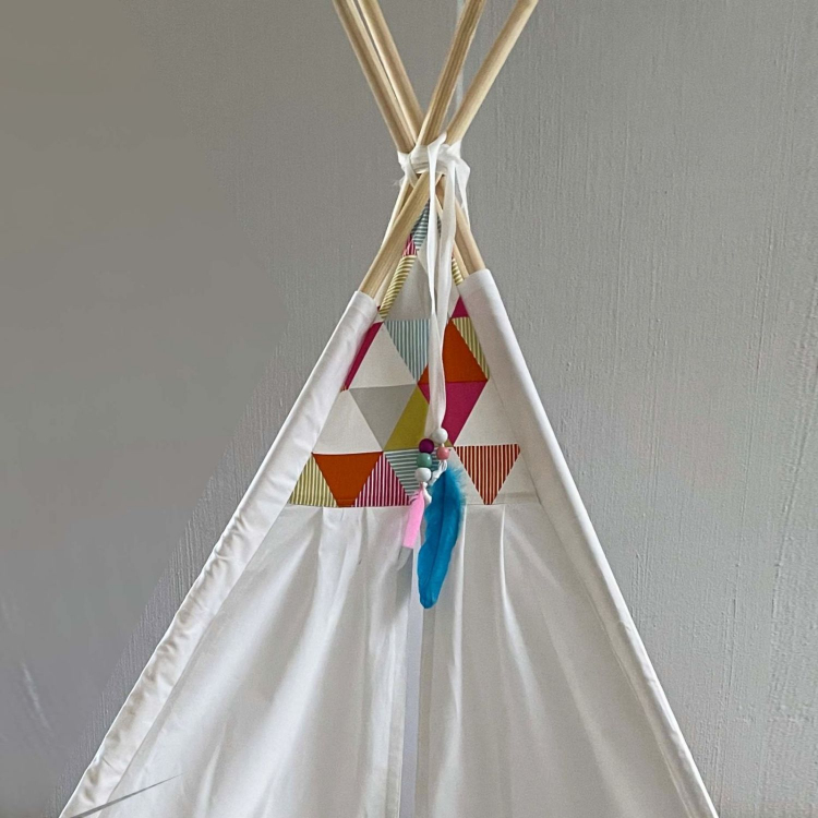 White teepee with colourful triangles details